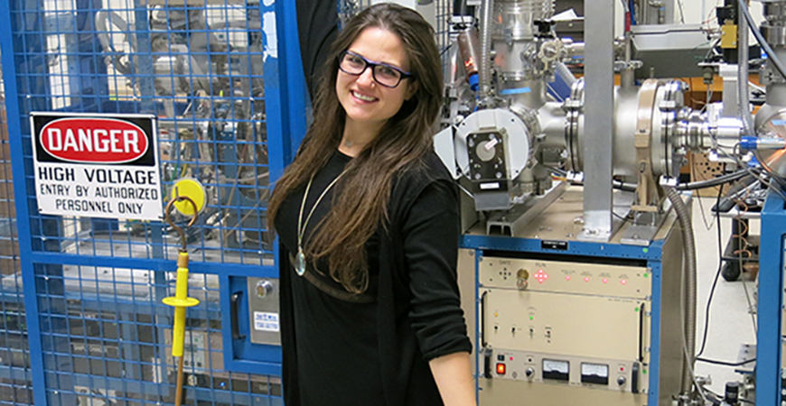 Kimber Moreland with the accelerator mass spectrometry (AMS) instrument. Photo courtesy of Lawrence Livermore National Lab: LLNL-PHOTO-769483.