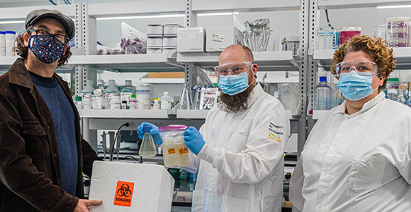 Professor Beutel (left) delivers samples to Professor Sistrom (center) and his doctoral student Shari Larsen (right).